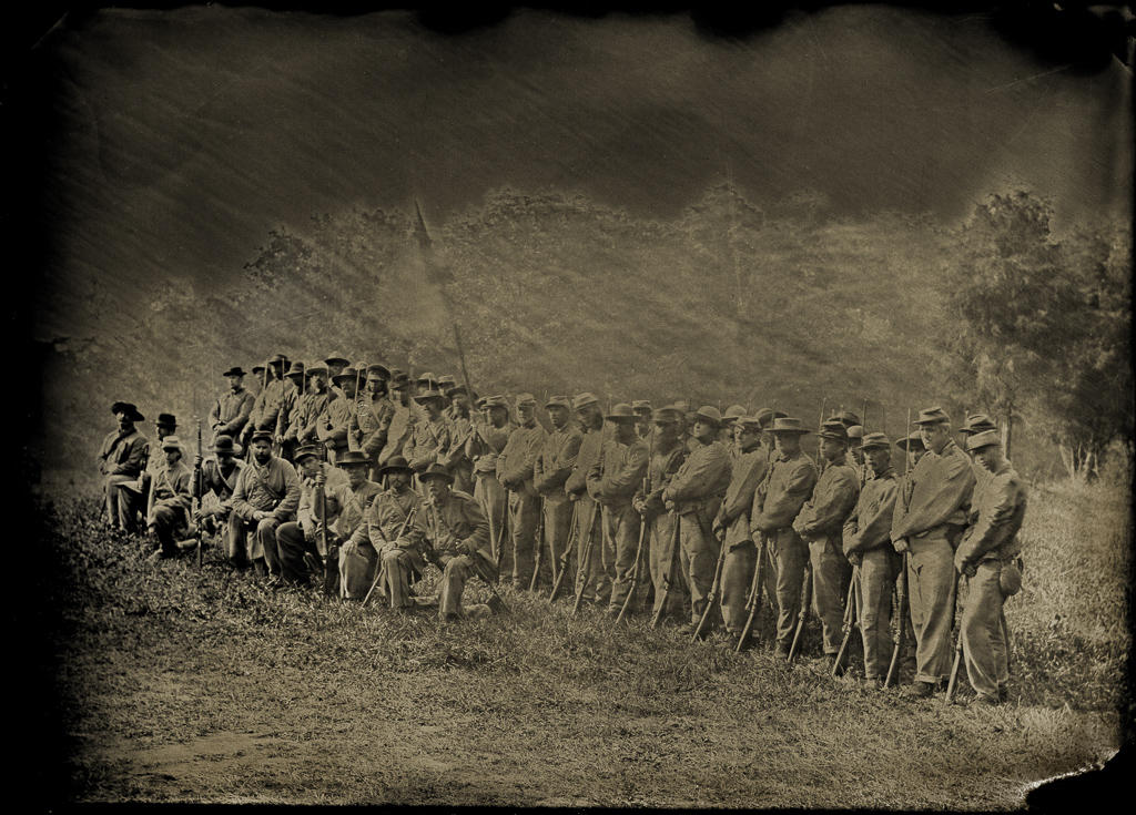 Confederate Civil War reenactors at South Mountain, Maryland show company strength following a battle. Wet plate photograph.